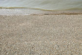 Sea and shingle beach — Stock Photo