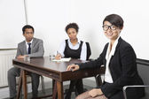 Asian female with multiethnic colleagues — Stock Photo