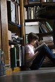 Teenage girl at library — Stock Photo