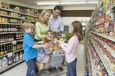 Family shopping in supermarket — Stock Photo