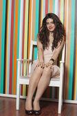 Beautiful woman sitting on chair — Stock Photo
