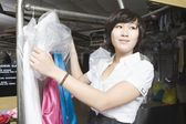 Woman working in the laundrette — Stock Photo