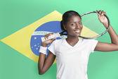 ブラジルの国旗に対してテニス ラケットを持つ女性 — ストック写真