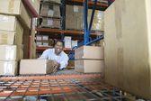 Man stacking boxes — Stock Photo