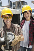 Female industrial worker with coworker — Stock Photo