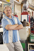 Man in automobile workshop — Stock Photo