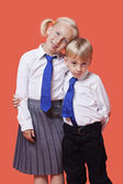 Siblings in school uniform — Stock Photo