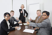 Multiethnic business people thumbs up — Stock Photo