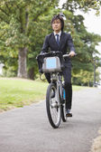 Businessman commuting by his bicycle — Stock Photo