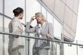Businesswoman arguing with female colleague — Stock Photo