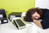 Woman asleep at desk — Stock Photo