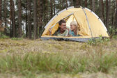 Couple camping in forest — Stock Photo