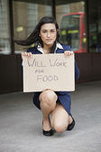"""Businesswoman holding """"Will Work for Food"""" sign — Stock Photo"""
