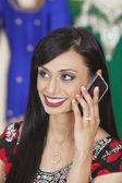 Indian woman answering phone call — Zdjęcie stockowe