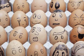Funny faces on painted on eggs — Stock Photo