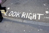 Road marking saying Look Right — Stock Photo
