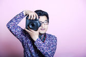 Asian Photographer with camera — Stock Photo
