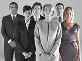 Ambitious businesswoman with team — Stock Photo