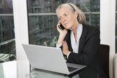 Senior businesswoman with laptop — Stock Photo