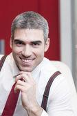 Businessman smiling at camera — Stock Photo