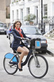 Businesswoman commuting by bicycle — Stock Photo