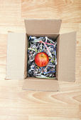 Apple wrapped up in a box — Stock Photo