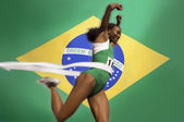 Track athlete crossing finishing line — Stok fotoğraf
