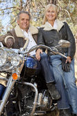 Senior couple with motorcycle — Stock Photo