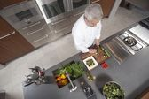 Mid- adult chef prepares salad  overview — Stock Photo