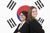 Multiethnic businesswomen over Korean flag — Stock Photo