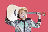 Boy carrying guitar with Dutch flag — Foto de Stock