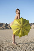 Naked woman with umbrella — Stock Photo