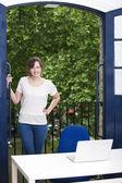 Businesswoman standing by balcony — Stock Photo