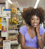 Woman in hardware store — Stock Photo