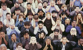 Crowd covering ears — Stock Photo