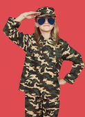 Girl in military uniform saluting — Stock Photo