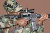 US Marine Corps soldier aiming M4 assault rifle — Stock Photo
