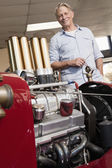 Car engine and man — Stock Photo