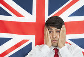 Man against British flag — Foto Stock