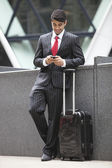 Indian businessman with luggage bag — Stock Photo