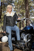 Senior woman with motorcycle — Stock Photo