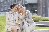 Businesswomen taking self portrait — Stockfoto
