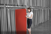 Businesswoman holding thin red veneer sheet — Stock Photo