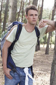 Man with backpack in woods — Stock Photo