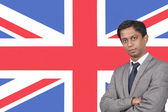 Businessman over British flag — Stock Photo