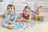 Girl and brother with cards — Stock Photo