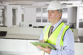 Man in reflector vest and hard hat — Stock Photo