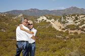 Senior couple hug with desert — Stock Photo