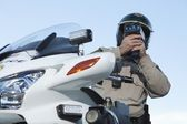 Officer looking through speedometer — Stock Photo