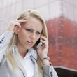 Angry businesswoman conversing on cell phone — Stock Photo #34009231